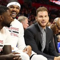 Blake Griffin in Street Clothes on the bench next to a Laughing Josh Smith