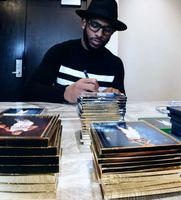 Chris Paul Autographing DVDs for Fans