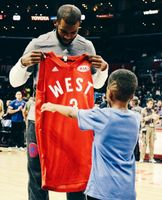 Chris Paul & His Son look at CP3's Red 2016 All-Star Jersey