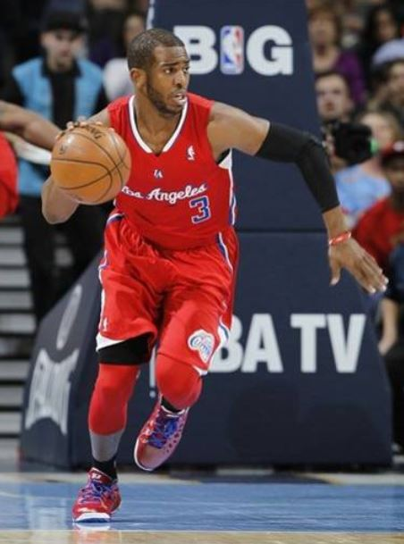 Chris Paul looks to push the ball in a red Clipper jersey - Clippers ... 3fa7e2ffc
