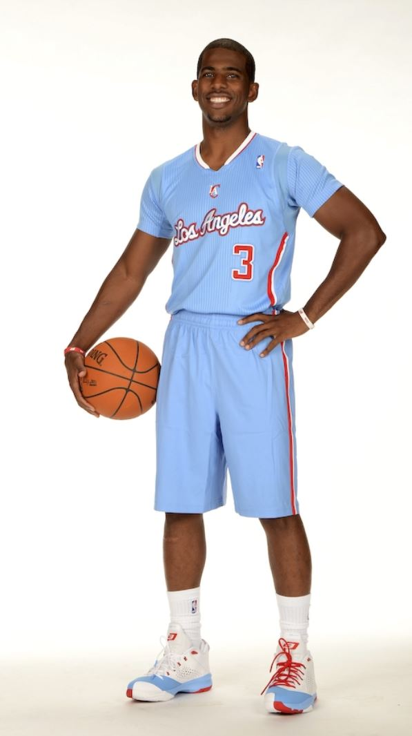 newest 1dc63 7e68c Chris Paul smiles in light blue Clippers jersey holding ball ...
