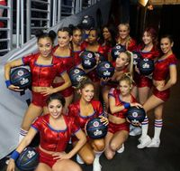 Clipper Spirit Girls in Various Hairdos Pose with Black Clippers Basketballs