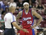 Corey Maggette listens to the referee's explanation.jpg
