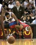 Maggette and Artest fight for the loose ball.jpg