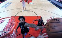 DeAndre Jordan Battles for a Rebound inside vs the Chicago Bulls