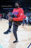 DeAndre Jordan Stretches His Left Thigh During Warm Ups in Denver