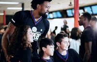 DeAndre Jordan and Young Clipper Fans 2016 Jeff Green in the Background