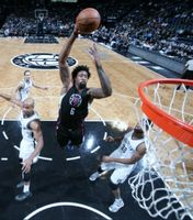 DeAndre Jordan in Black Clippers Jersey Flies in for a dunk in Brooklyn