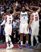Clipper Teammates Chris Paul DeAndre Jordan & Wesley Johnson exchange high-fives