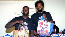 Clipper Teammates Lance Stephenson & DeAndre Jordan Hold up Grocery Bags at Charity Event