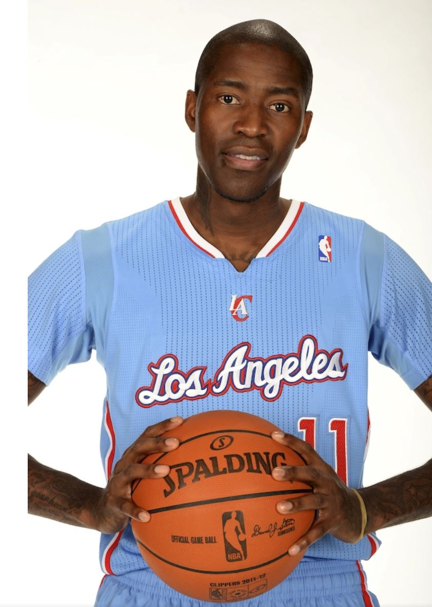Jamal Crawford holds basketball in 2 hands wearing new Clipper
