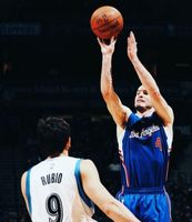 JJ Redick Launches a Jumper over Ricky Rubio 2015