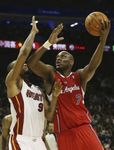 Lamar Odom in a Clipper red road jersey puts up a baby hook inside vs Rashard Lewis.JPG