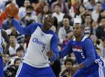 Lamar Odom receives the ball in the post vs Caron Butler during practice in China.JPG