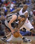 Lamar Odom tries to strip the ball from Manu Ginobilli.JPG
