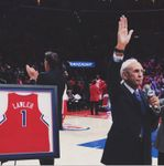 Ralph Lawler Thanks the Crowd during Ralph Lawler Day 2015 next to his Jersey